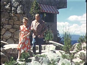 Mae and George walking down the path at the Lodge.